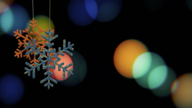 Christmas Snowflake Ornaments are Swinging on Bokeh Background Loopable File video
