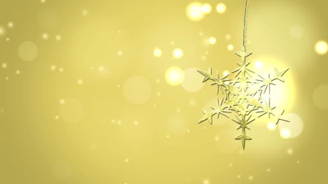 christmas star falling down in front of golden bokeh light background video
