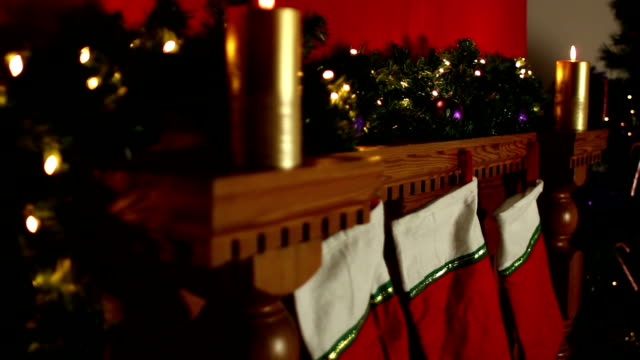 Christmas stockings hung on Fireplace - Dolly Stock HD video clip footage of a Fireplace with Christmas stockings hung up hanging stock videos & royalty-free footage