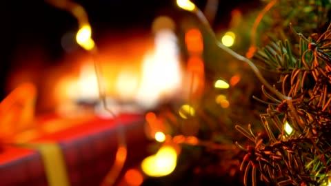 Christmas three on glow fireplace bokeh lights background Christmas three on glow fireplace bokeh lights background. christmas tree stock videos & royalty-free footage