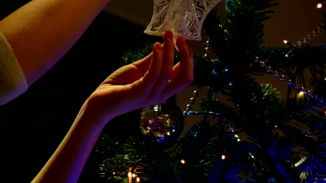 Christmas tree being decorated by a young girl video