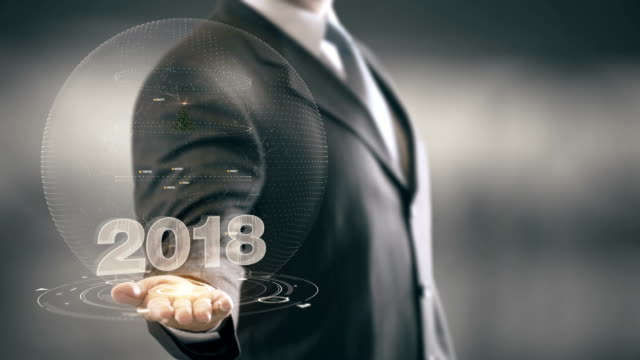 vidéos et rushes de 2018 de sapin de noël, homme d'affaires en tenant dans la main de nouvelles technologies - 2018