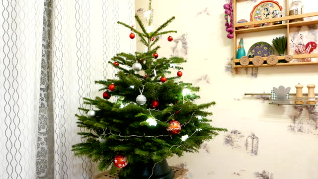 Christmas tree decoration time lapse, red and silver ornaments on fir tree video