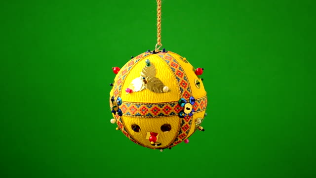 Christmas tree decoration Christmas tree decoration on a green background christmas ornament stock videos & royalty-free footage