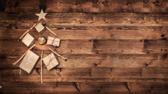 vídeos de stock e filmes b-roll de christmas tree made of wooden branches - christmas card