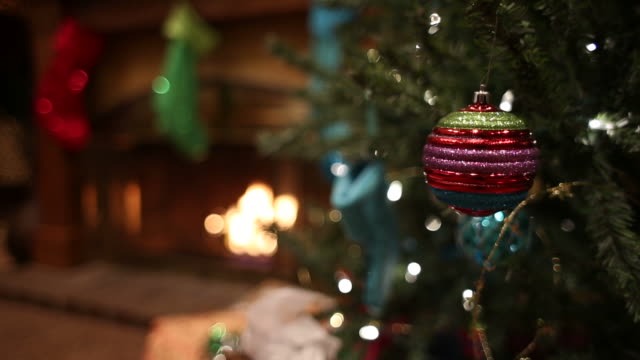 Christmas Tree Ornament Fireplace Background Shot in Moreno Valley, California in December of 2014.  Canon 5D mark3. christmas stocking stock videos & royalty-free footage