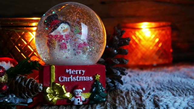 Christmas tree, Santa Claus toy and snowman in snow globe