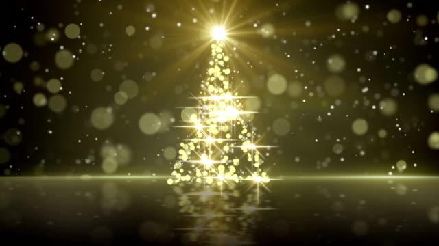 ゴールドのクリスマス ツリー形状睨む単発 - クリスマスツリー点の映像素材/bロール