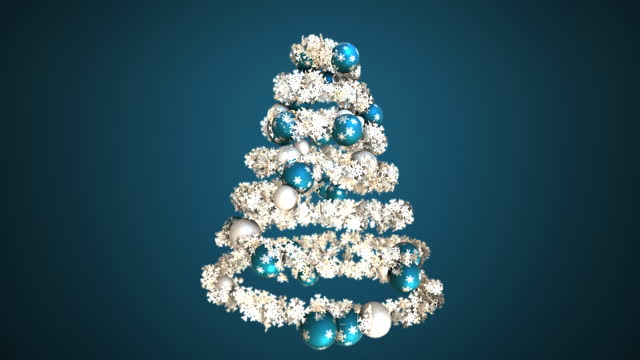 Christmas tree with blue and silver baubles and snowflakes.