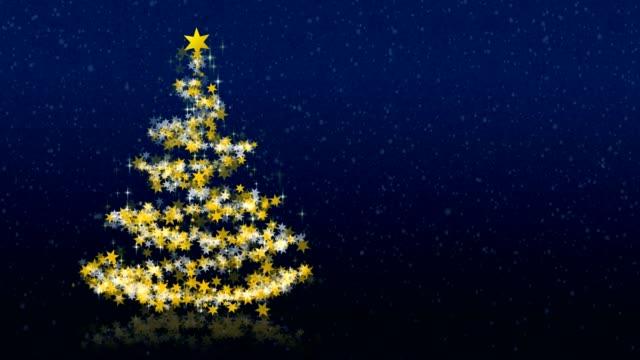 julgran med glittrande stjärnor på blå bakgrund - blue yellow bildbanksvideor och videomaterial från bakom kulisserna