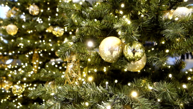 Christmas tree with gold decoration close up video