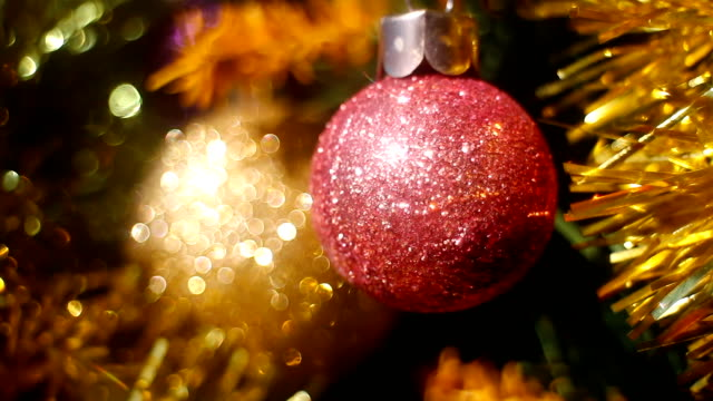 Christmas tree with ornaments and defocused lights Christmas tree with ornaments and defocused lights christmas ornament stock videos & royalty-free footage