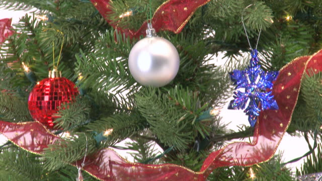 christmas tree with red, blue and silver ornaments - tilt down stock videos & royalty-free footage