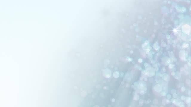 Christmas, wedding, celebration background loop: Defocussed snow or glitter, silver. video