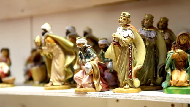 christmas woman shopping in market store, magi statuette video