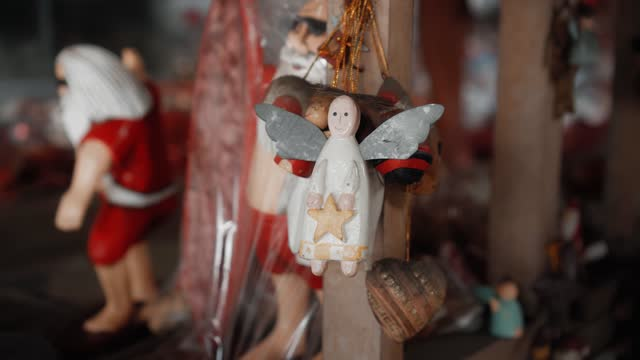 Christmas wooden toys of angel hanging in the house