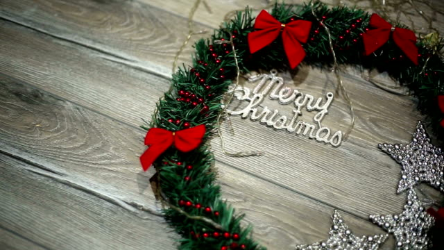 Christmas wreath with decorations on the shabby wooden background video