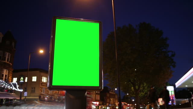 Chroma Key Billboard On The Street Close-up Shot Of A Billboard With Green Screen. Billboard Was Shot As Stabilized Low Angel View. Traffic Flow Is Seen As Time Lapse In The Background. Footage Is Suitable For Advertisements. billboard stock videos & royalty-free footage