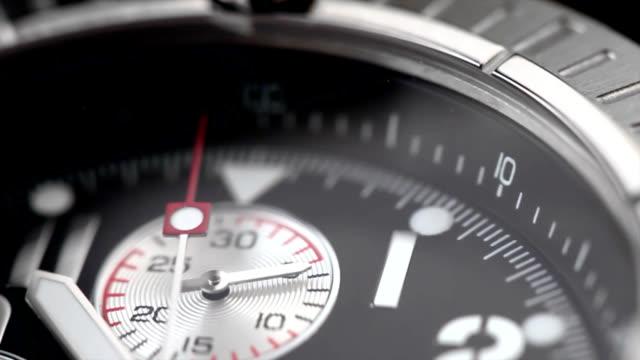 chronograph watch with a second hand - armbandsur bildbanksvideor och videomaterial från bakom kulisserna