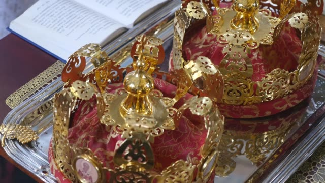 Church attributes for wedding ceremony. Gold crowns are on the altar. Attributes of priest. Interior of church Church attributes for wedding ceremony. Gold crowns are on the altar. Attributes of priest. Interior of church. royalty stock videos & royalty-free footage