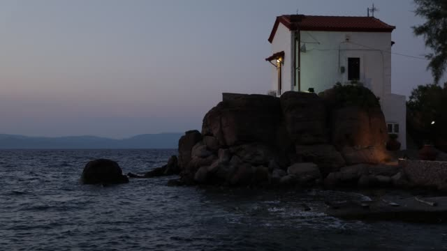 Church by the sea Time lapse of a small church in Scala Scamnia Lesbos Greece aegean islands stock videos & royalty-free footage