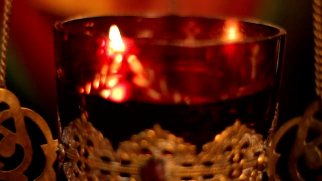 church candle burn in the church - candeliere video stock e b–roll
