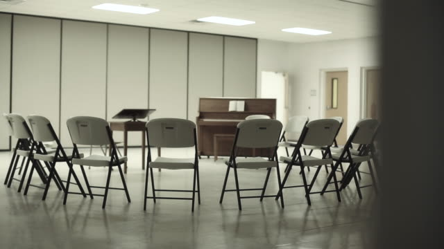 Church Fellowship Hall Chairs Gathered In Circle Around Piano Close Up Church Fellowship Hall Chairs Gathered In Circle Around Piano Close Up chair stock videos & royalty-free footage