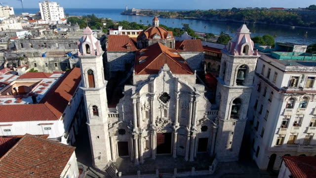 Church In Old Havana Cuba With Drone Flying In Sky Drone flying over Old Havana, Cuba: The baroque cathedral in Habana Vieja district. Aerial view of La Habana, Cuban capital city. Urban landscape from the sky with building, landmark, monument cathedrals stock videos & royalty-free footage