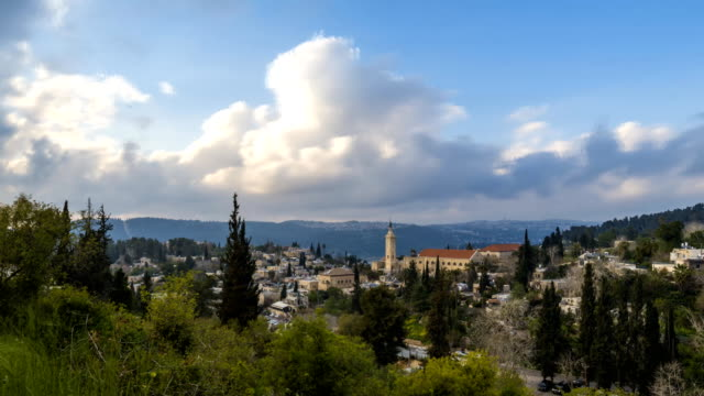 Church of Saint John the Baptist in Ein Karem/Kerem neighborhood; time lapse Time lapse of clouds moving over Ein Karem, biblical birth place of John the Baptist, with Catholic Church of Saint John the Baptist; Jerusalem Israel religious text stock videos & royalty-free footage