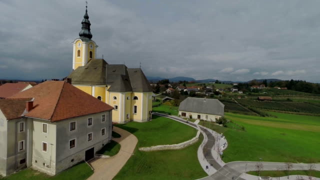 Church on the hill in the middle of a countryside video