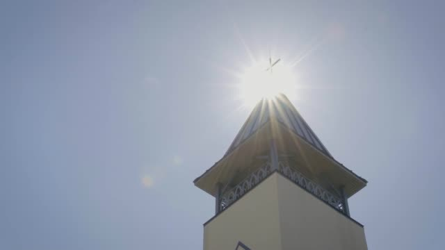 church tower revealed in sun - christening stock videos and b-roll footage