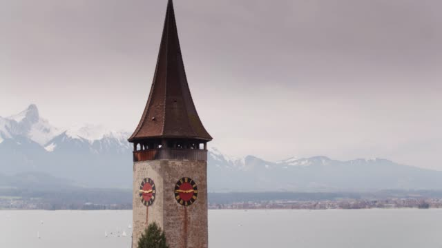 Church Tower with Alpine Backdrop, Oberhofen am Thunersee, Switzerland video