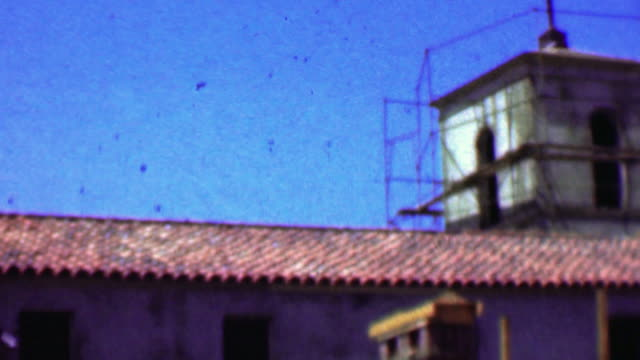 1957: Church under construction clay tile roof concrete materials. video