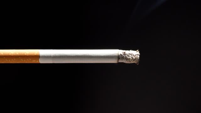 cigarette burning - sigaretta video stock e b–roll