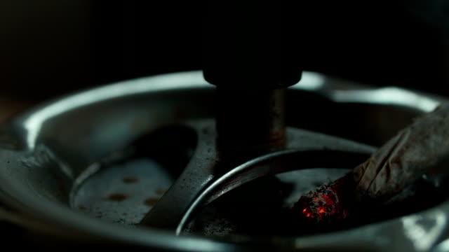 A cigarette in an ashtray video
