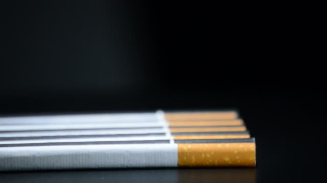 Cigarettes rotating on black background video