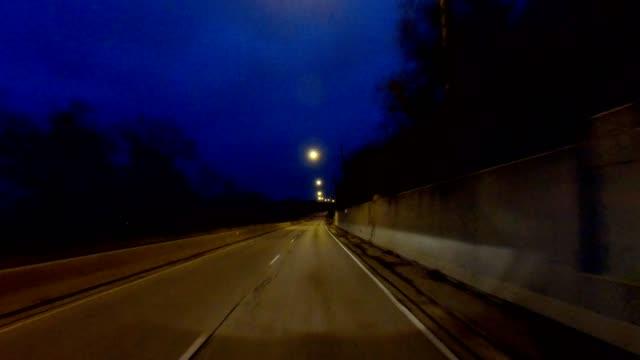 stockvideo's en b-roll-footage met cincinnati v gesynchroniseerd series front bekijken proces plaat nacht rijden - twilight