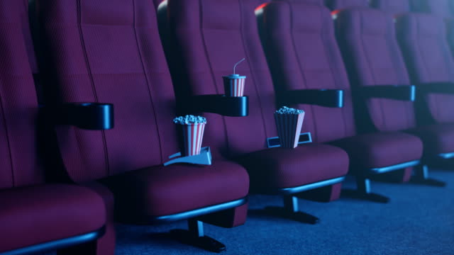 Cinema movie watching. Composition with 3d glasses, popcorn and cup with a drink. Cinema concept with blue light, 3D animation