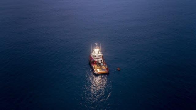 cinemagraph boat alone - łowić ryby filmów i materiałów b-roll