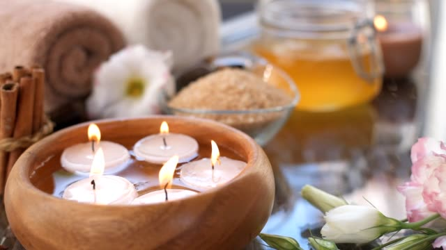 cinemagraph - burning candles in water. composition of spa. - naturopathy stock videos and b-roll footage