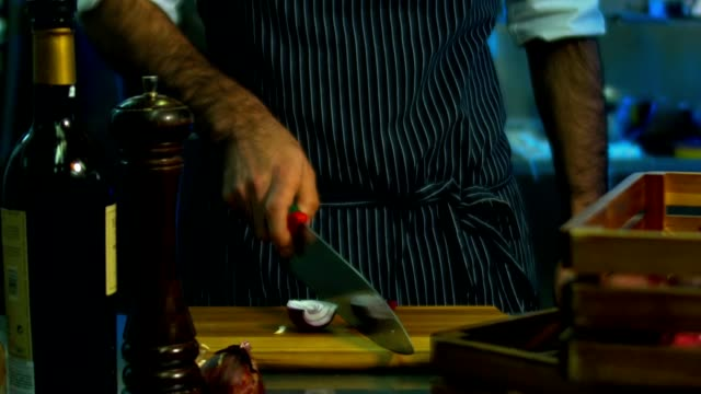 HD cinemagraph. Chef cutting the onion video