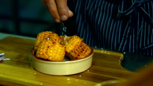 HD cinemagraph. Chef sprinkling corn with salt video