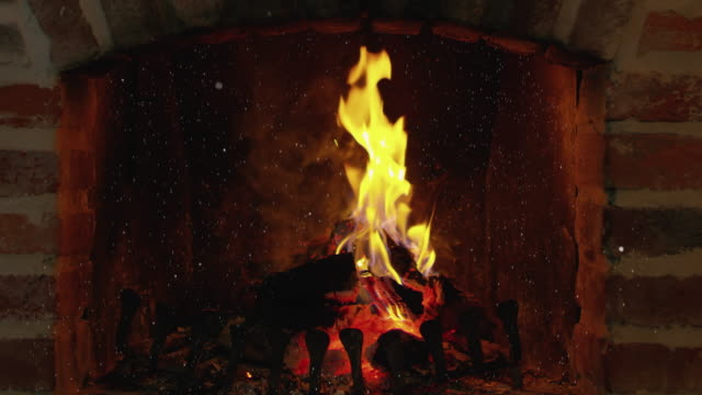 WS Cinemagraph effect of a snow falling over a fireplace video