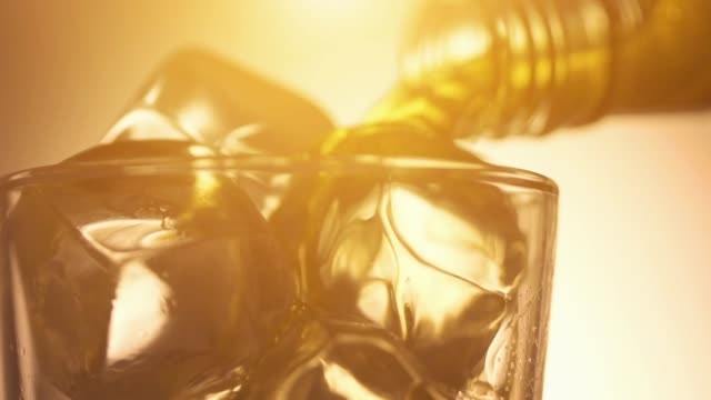 Cinemagraph loop - pouring scotch whiskey over ice
