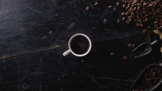 cinemagraph of a cup of fresh hot coffee - pausa caffè video stock e b–roll