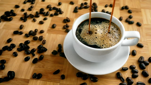Cinemagraph of Coffee Pouring in a Cup video