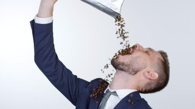 cinemagraph of man pouring coffee beans in seine mündung - koffeinmolekül stock-videos und b-roll-filmmaterial