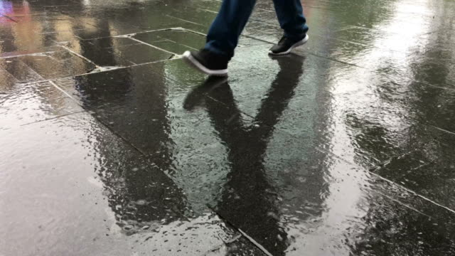 Cinemagraph of man walking in the rain video