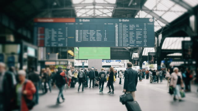 Cinemagraph of People commuting  at train station in Switzerland Cinemagraph of People commuting  at train station in Switzerland railroad station platform stock videos & royalty-free footage
