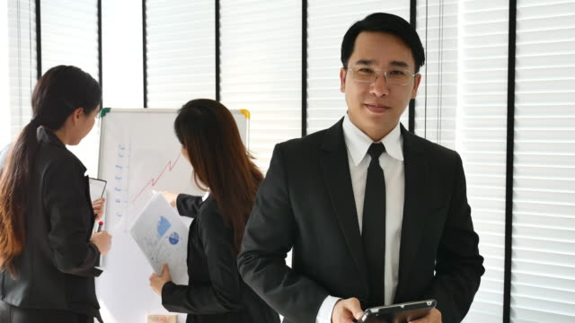 Cinemagraph of Portrait Asian Businessman video